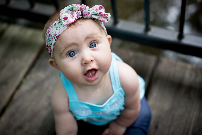 04-minneapolis-photographer-baby-girl-big-blue-eyes-wooden-bridge-mahonen-photography.jpg