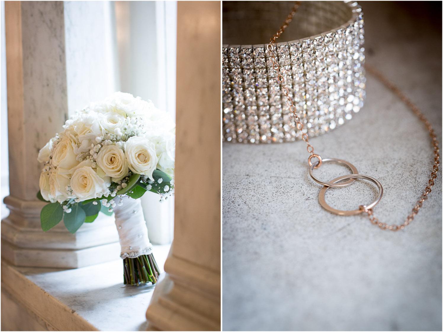 04-the-landmark-center-st-paul-minnesota-wedding-photographer-bridal-details-rhinestone-bracelet-bouguet-white-roses-babys-breath-mahonen-photography.jpg
