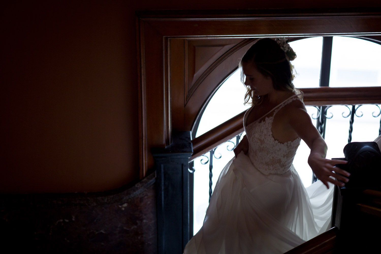 07-the-landmark-center-st-paul-mn-wedding-photographer-moody-stairwell-light-mahonen-photography.jpg