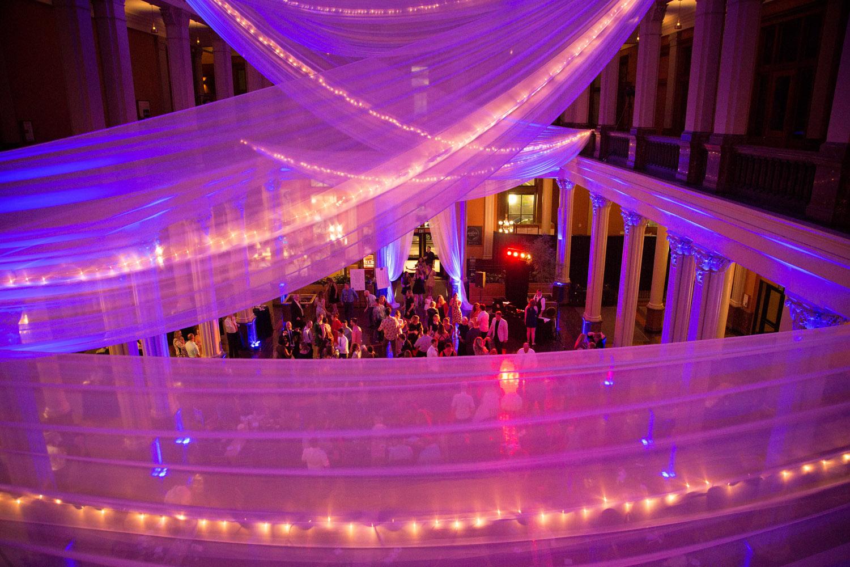 29-the-landmark-center-st-paul-mn-wedding-photographer-reception-fun-dance-dancing-linens-drapery-twinkle-lights-pink-uplighting-mahonen-photography.jpg