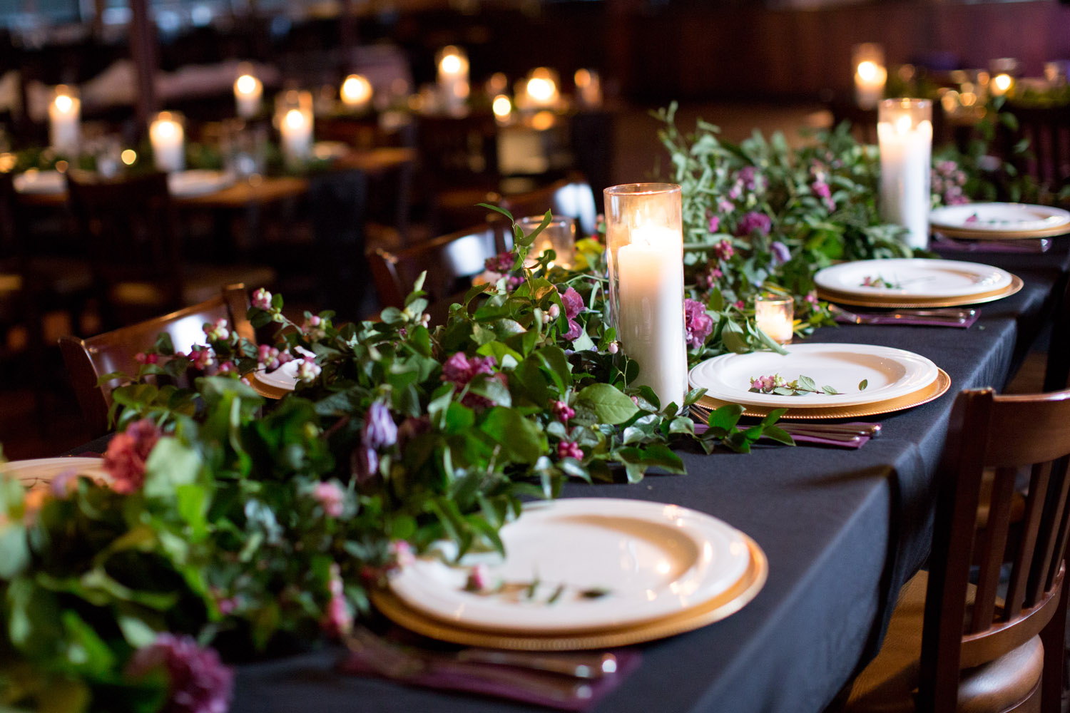 21-crooners-jazz-club-music-wedding-photographer-styled-shoot-reception-details-table-settings-place-setting-black-table-cloth-gold-charger-plum-napkins-head-table-candles-mahonen-photography.jpg