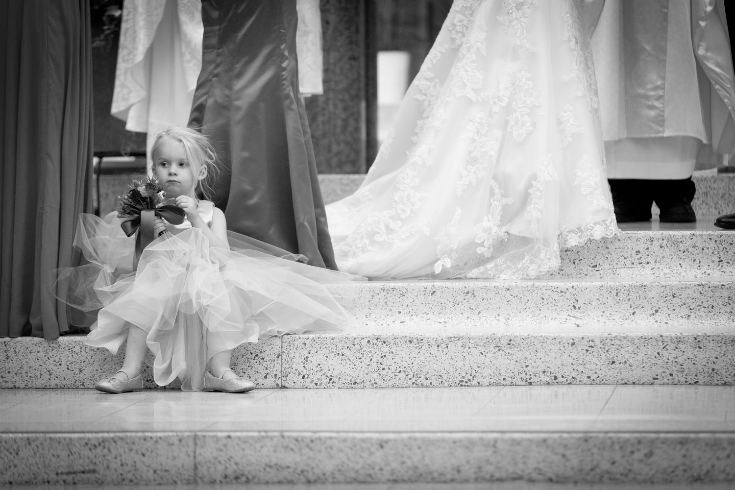 Being flexible and letting kids be kids (to a certain extent) is also important. Choose your battles. This little flower girl wanted to sit next to her momma during the ceremony. No sweat.