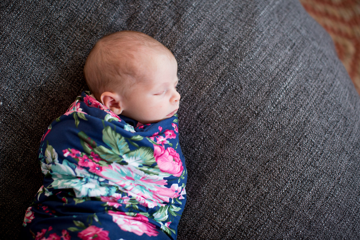 04-in-home-lifestyle-minnesota-newborn-photographer-navy-pink-floral-wrap-mahonen-photography.jpg
