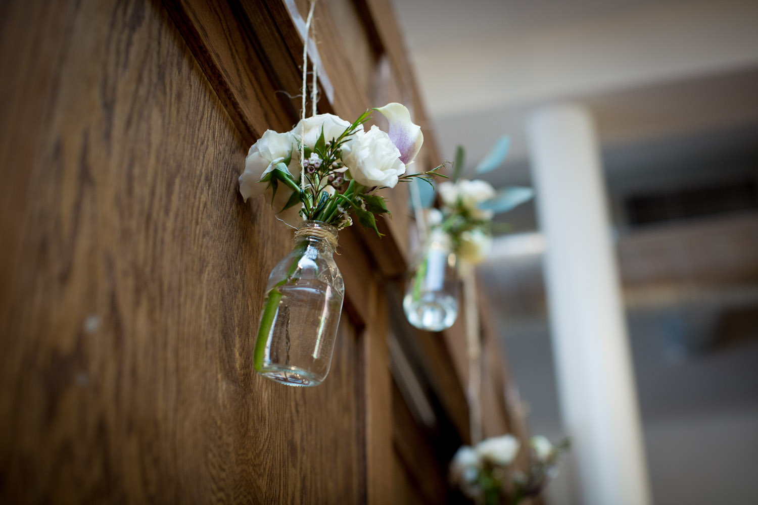 07-cornerstone-studios-wedding-professionals-small-events-ceremony-details-flowers-bottles-mahonen-photography.jpg