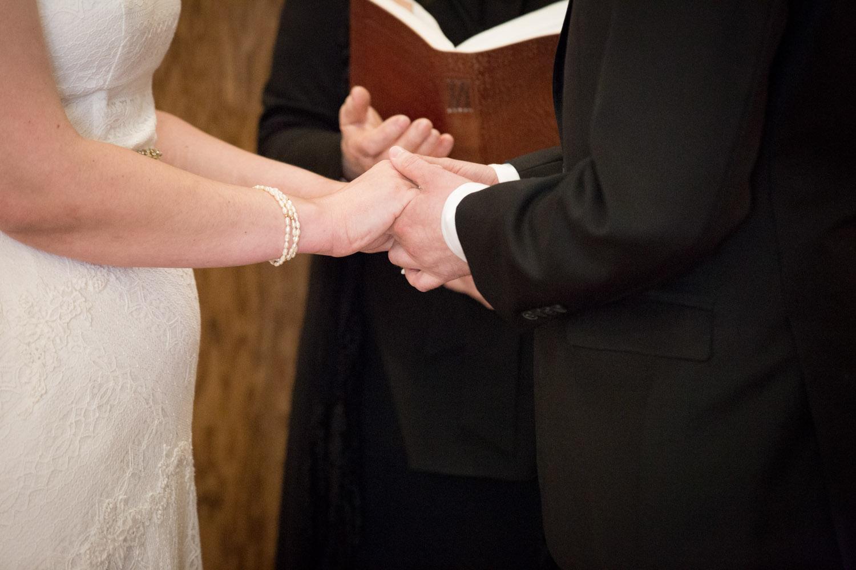 12-cornerstone-studios-wedding-professionals-small-events-ceremony-bride-groom-hands-close-up-mahonen-photography.jpg