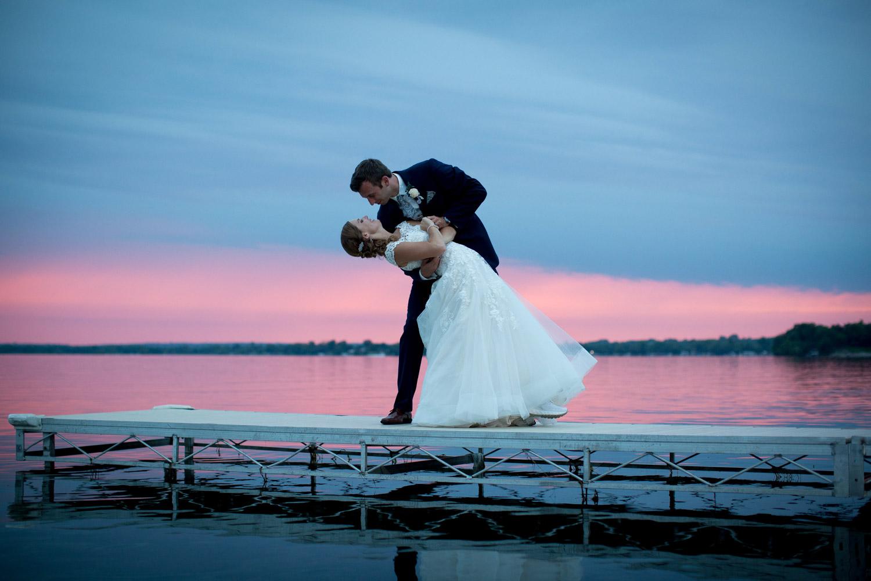 23-northern-minnesota-summer-lake-wedding-pink-overcast-sunset-bride-groom-lakeside-chophouse-mahonen-photography.jpg