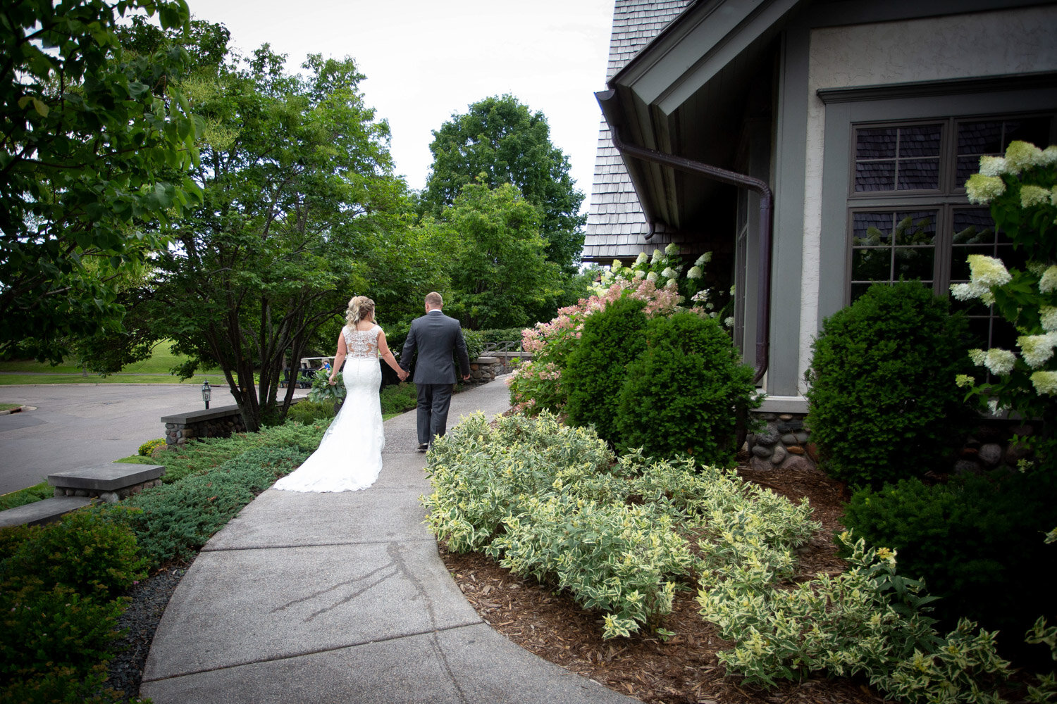 10-rush-creek-golf-course-bride-groom-portrait-outside-path-mahonenphotography-mn-wedding-photographer.jpg