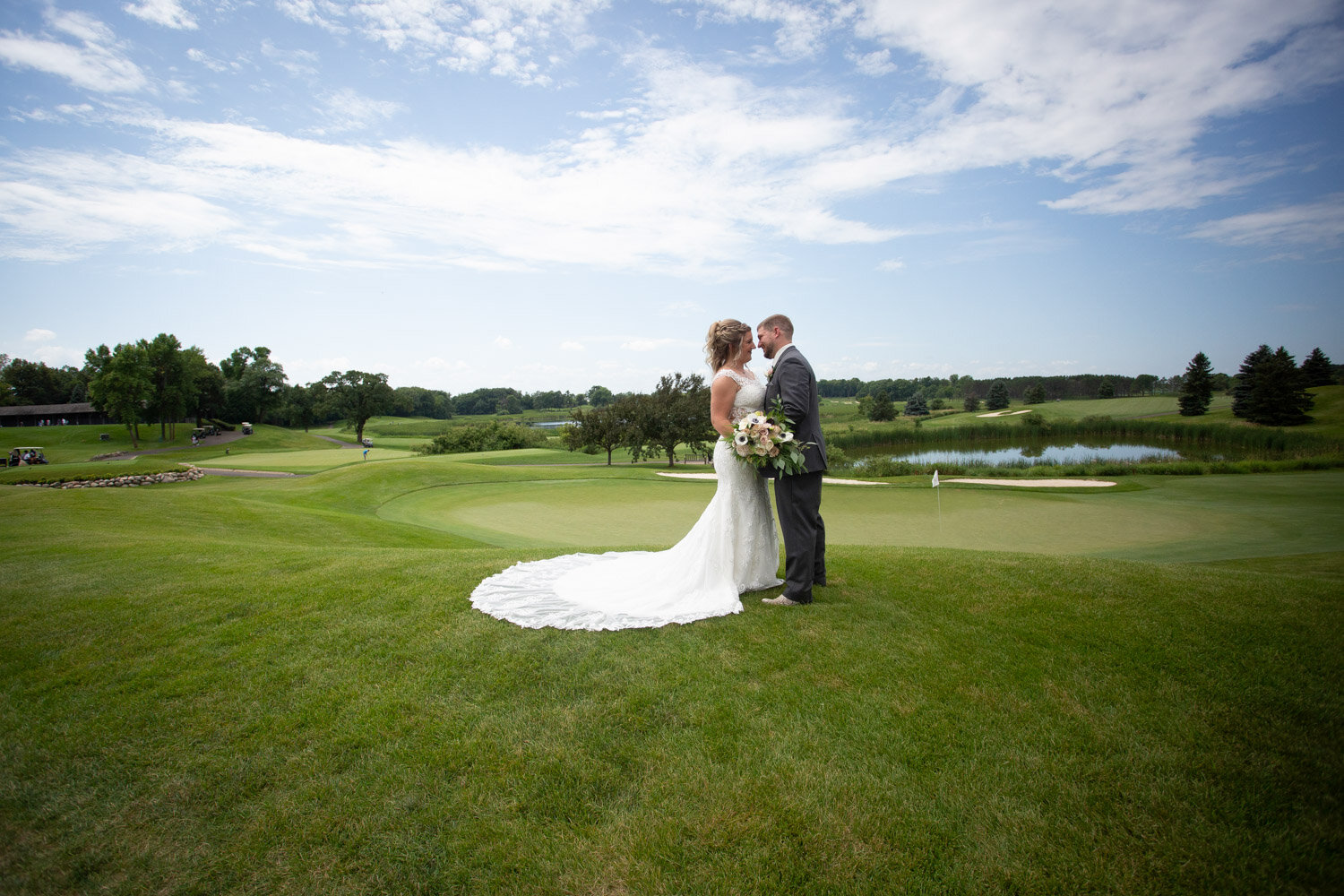 14-rush-creek-golf-course-bride-groom-portrait-outside-path-mahonenphotography-mn-wedding-photographer.jpg