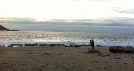 Kim Weston photographing on the beach.