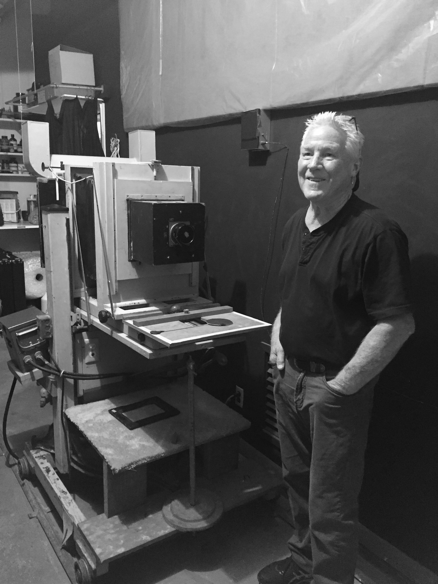Kim Weston standing next to Ansel's enlarger