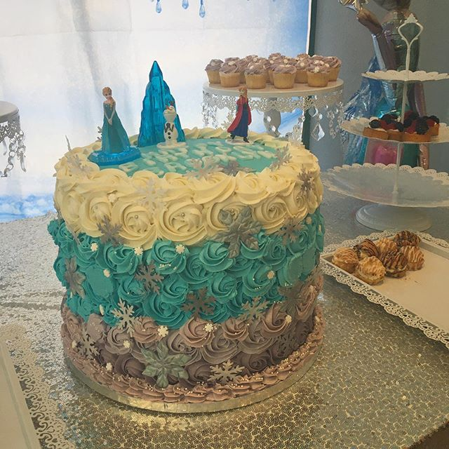 """Whew! This 12"""" Cake was our biggest one to date! Almost as tall as it was round, this white cake filled with blueberry cream layers and Swiss meringue buttercream rosettes was styled for a Frozen-themed birthday party. Got an event coming up? We've got the desserts for catering! Email for more details. Happy Monday! ❤️ . . . #catering #dessert #frozen #cake #birthday #event #bakery #nationaldessertday #yum #sandiego #smallbusiness #local #party #showers #wedding #celebrate"""