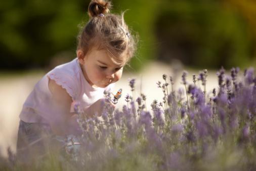 Girl smelling flower.jpg