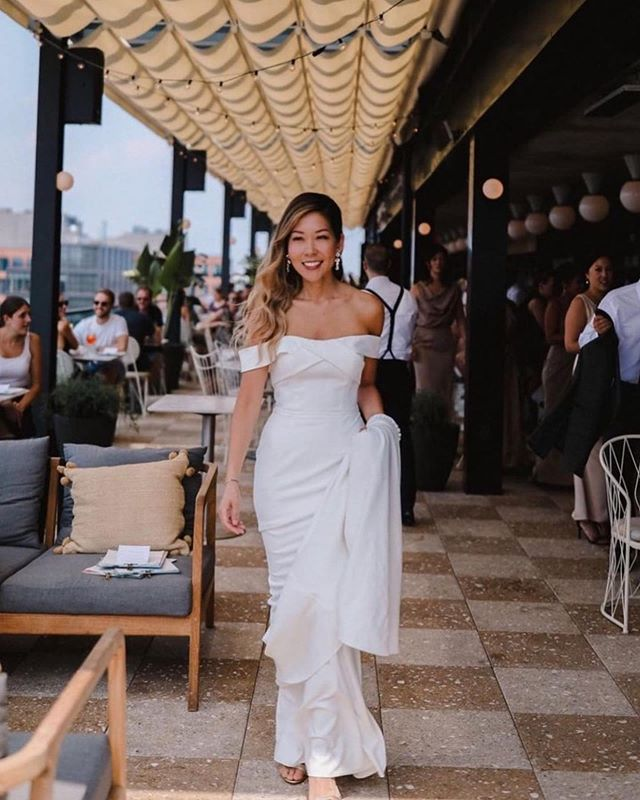 We teamed up with @youngsurvivalcoalition & @gabriellabridal to gift two engaged 💍 breast cancer survivor brides a wedding dress of their dreams... one of our gorgeous brides got married this past weekend in NYC and here's a sneak peek at her two-in-one look! The #GENEVAgown with detachable overskirt 🙌 Swipe to see! Congratulations Christina & Chris! 💕🎀 📸: @rebeccaouphotography #KellyFaetanini