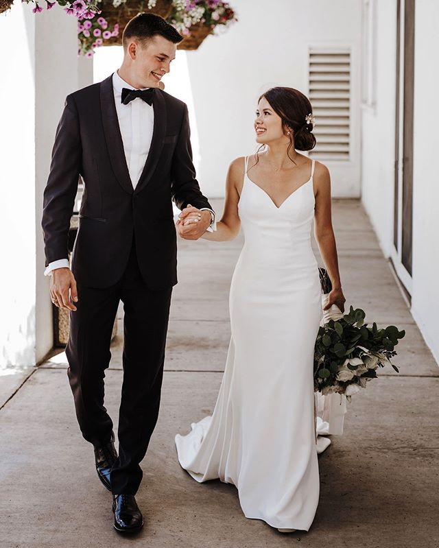 Classic. Chic. CREPE! #KellyFaetanini bride Phoebe looking glamorous in her #TAMORAgown (made in our flattering heavy crepe fabric) 🖤 Photo by @clewellweddings #KFbride