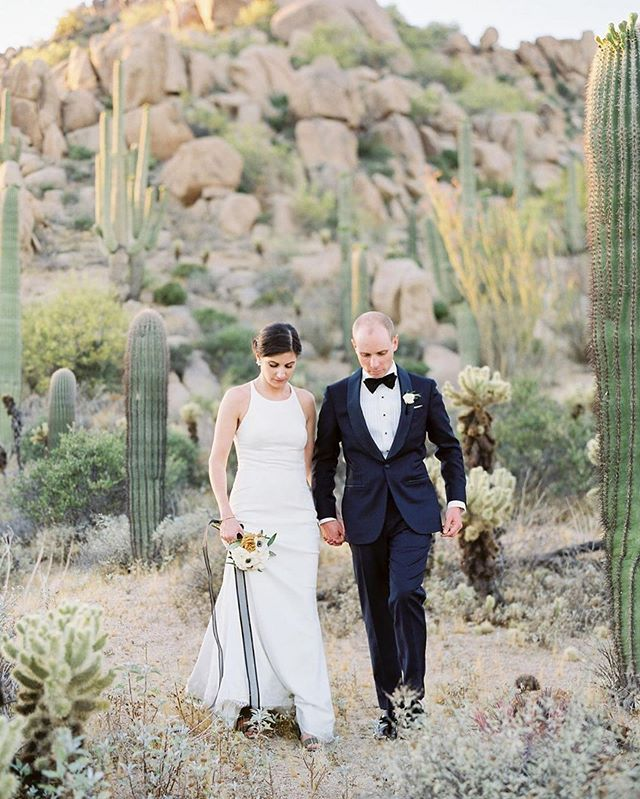 New Yorkers Leah & Troy fell in love with the desert and had a stunning destination wedding in Arizona! 🌵 #KellyFaetanini bride in the #ARIAgown 📸: @rachelsolomonphoto . Planning @sipandtwirl | Venue @fsscottsdale #fsscottsdale #fourseasonsscottsdale | Floral @fiorifloralaz | Band @luckydevilsband | Hair & Makeup @kurstenann | Gown @kellyfaetanini via @gabriellabridal | Shoes @ferragamo | Groom @suitsupply | Rentals @eventrentsaz | Lighting @karmaeventlighting | Photobooth @phoenixgif | Film Lab @thefindlab #thefindlab #contax645 #fuji400h @fujifilm_profilm #ishootfujifilm