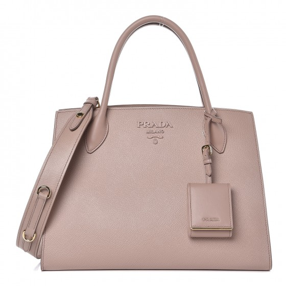 Prada Saffiano Leather - The gold standard for durable leathersWater resistant, difficult to scratchHolds colors exceedingly well and comes in a wide variety of hues to suit your wardrobe year-roundLightweight and easy to carryShown here in the Monochrome bag