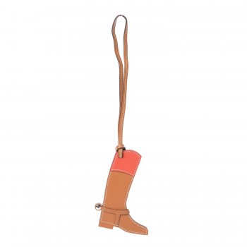 Hermes Boot Charms - The Hermes Paddock Botte (boot) charm complements the mini saddle with a mini rider's boot. You can really see the Hermes craftsmanship at work with the delicate stitching and attention to detail.Shop Hermes Boot Charms