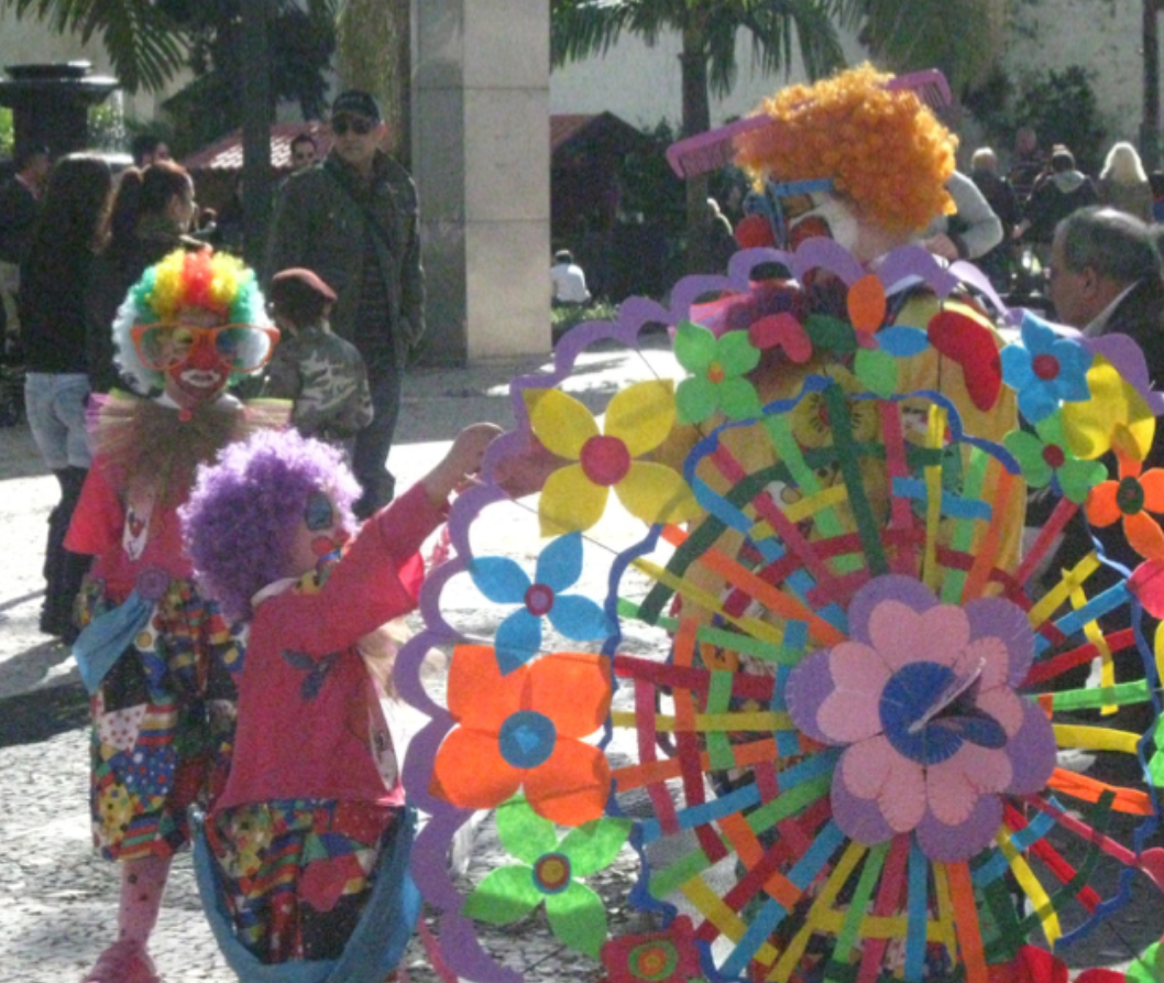 Adults and children interact during Carnaval in Funchal, Madeira