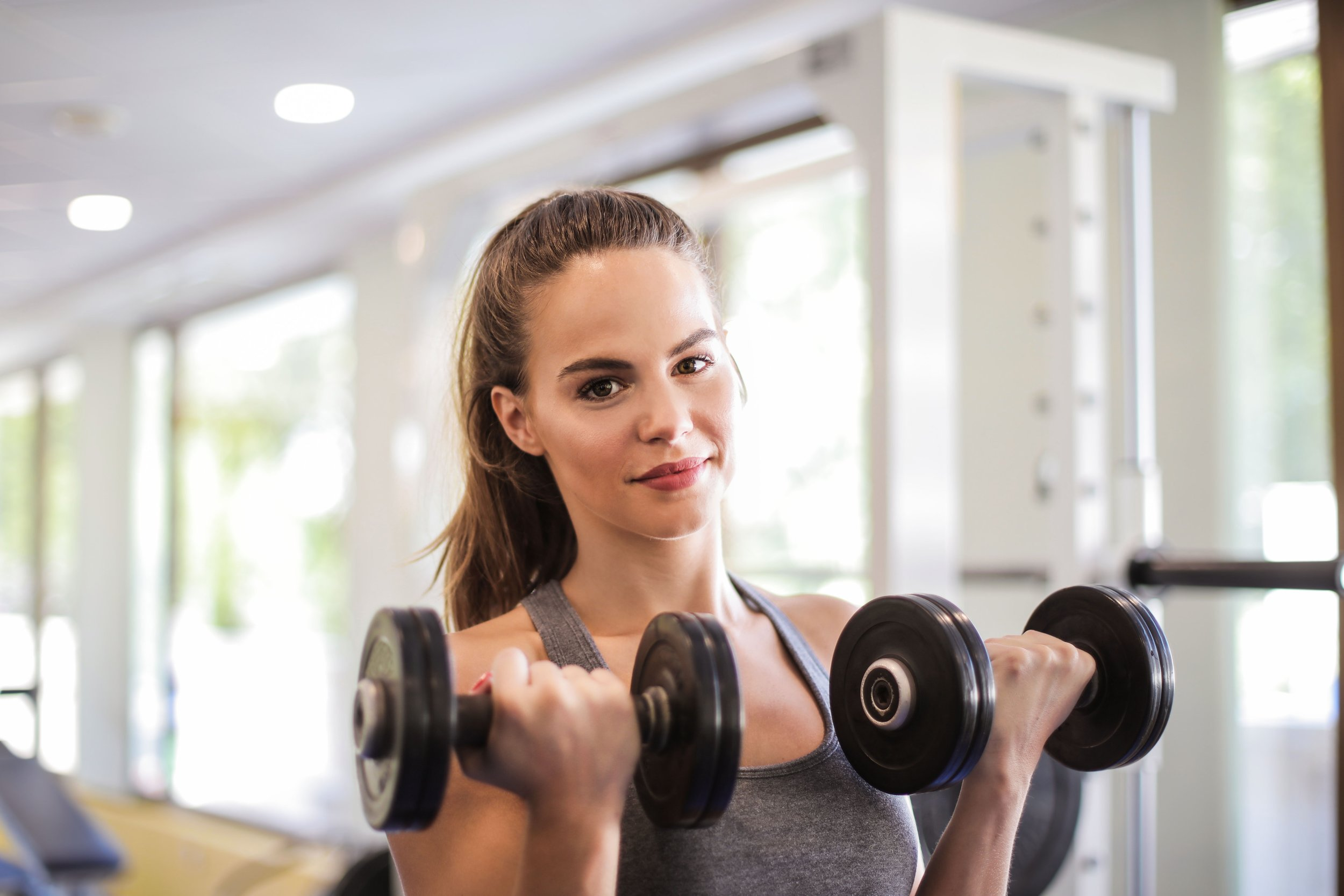 Woman lifting weights.jpg