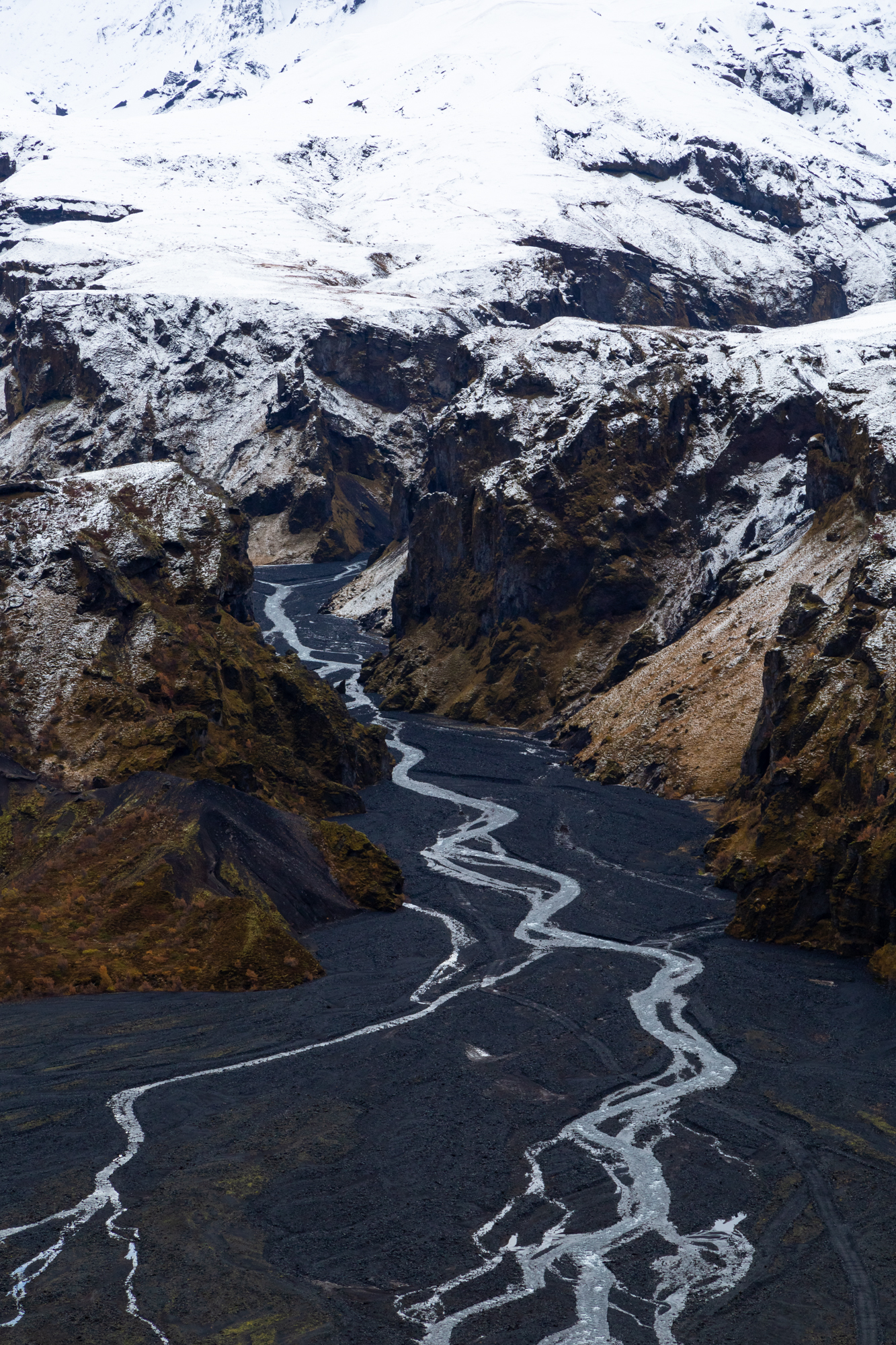 A braided stream pours from the glacier Eyjafjallajökull (pronounced eh-yaf-yatla-yo-kutl) that sits atop the volcano that famously erupted in 2010 and stoped air-travel over the Atlantic and mainland Europe. The unique combination of abundant volcanoes and glaciers in Iceland makes it a dramatic and rapidly changing landscape unlike any other on earth. As the glaciers in Iceland disappear this strange dynamic is becoming even more complex.