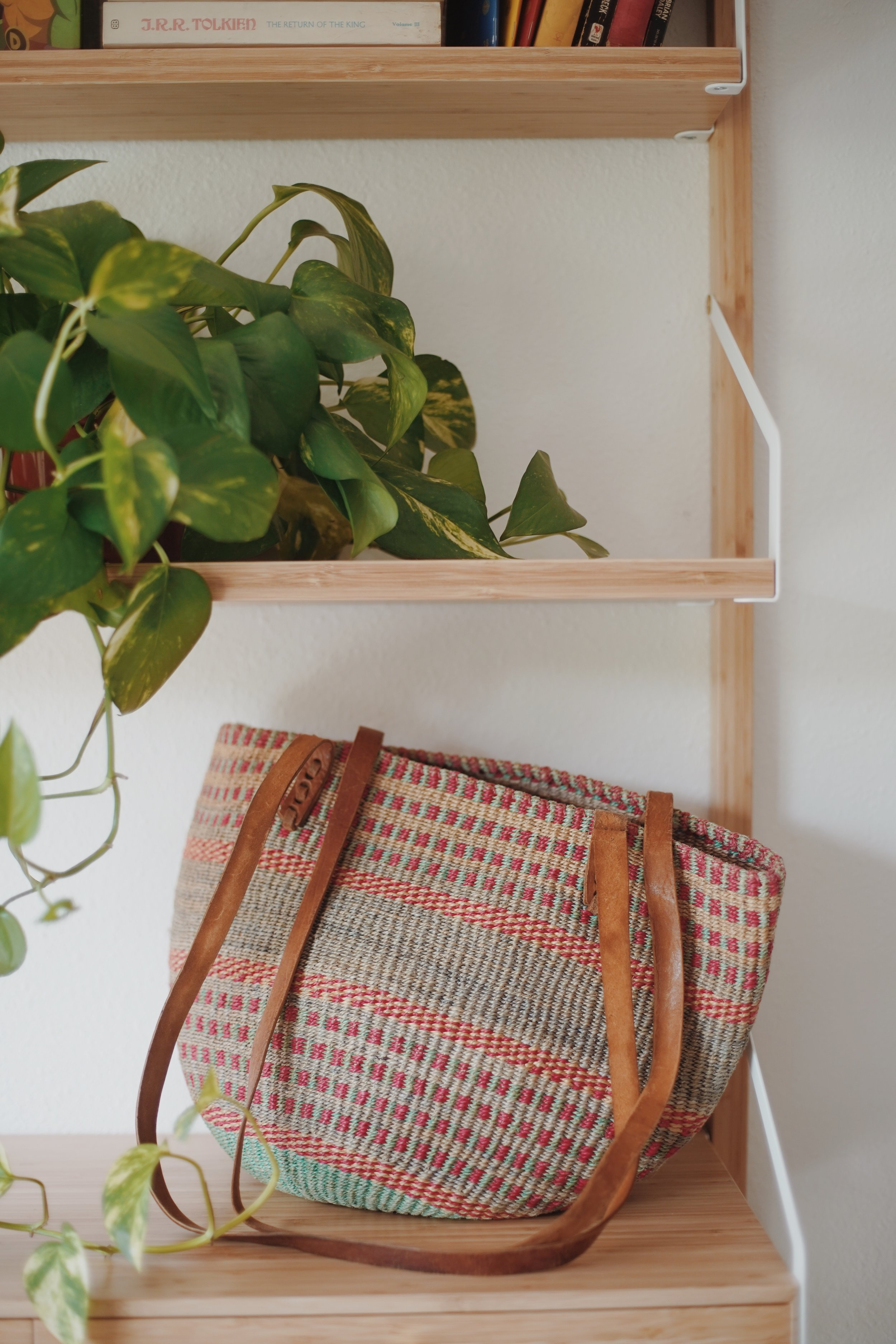 vtg woven bag - This woven bag is one of my favorite thrift finds to date. I found it at my local goodwill around Christmas in 2010. My wardrobe is pretty neutral, and I love the pop of color it provides. I always get compliments on it when I wear it! It was $4.99!!