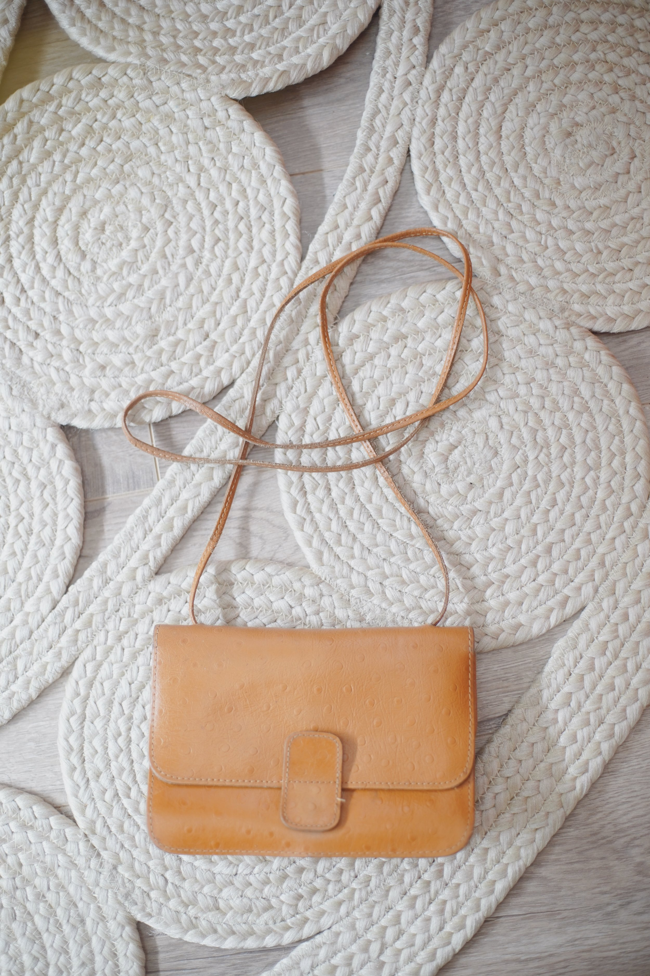 vtg leather bag - I found this bag the same day I found the woven tote (above). It fits my sunglasses, phone, cards, lip product, and not much else, but it's just so handy, I haven't felt the need to shop for another tiny bag. Plus, it has a little mirror inside!