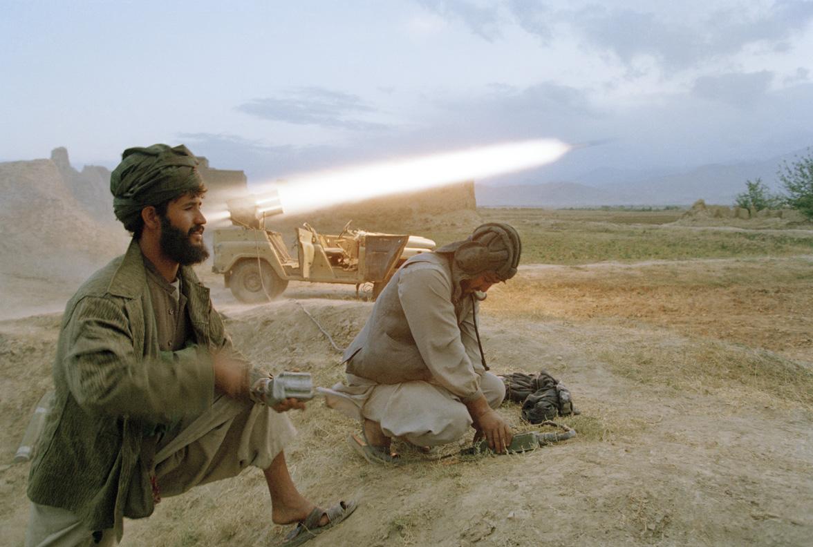 Taliban soldier fires a rocket, 2010