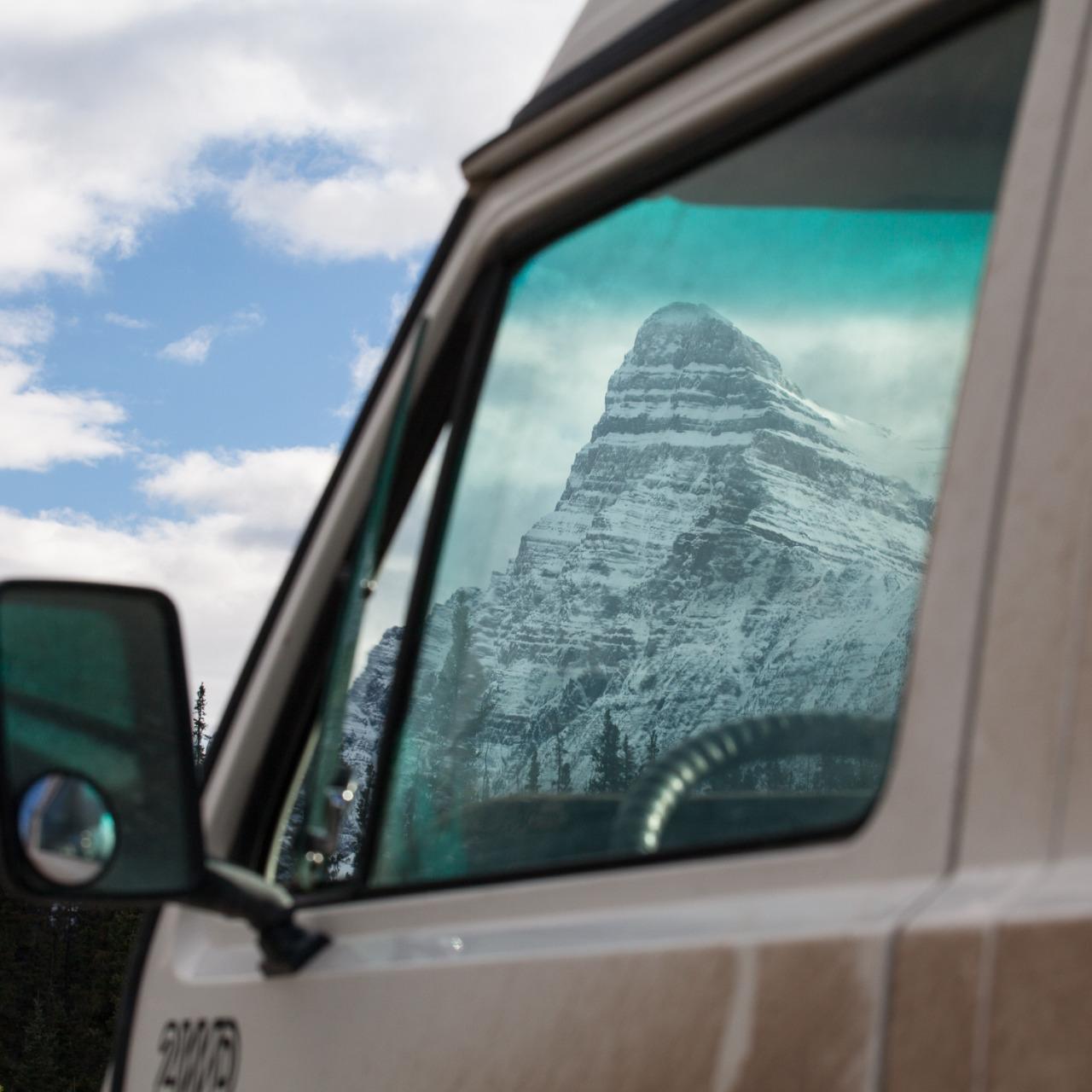 The Canadian Rockies through my van windshield