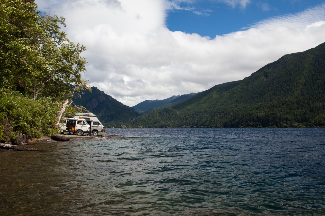 Volkswagen vans parked along Lake Crescent in the Olympic Peninsula, Washington.