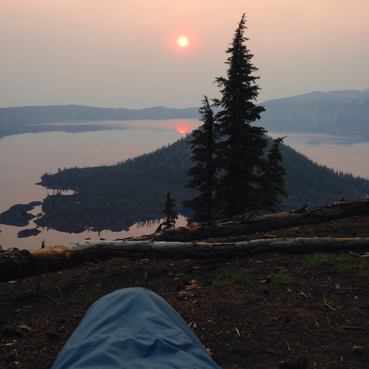 Waking up with a forest fire sunrise over Crater Lake