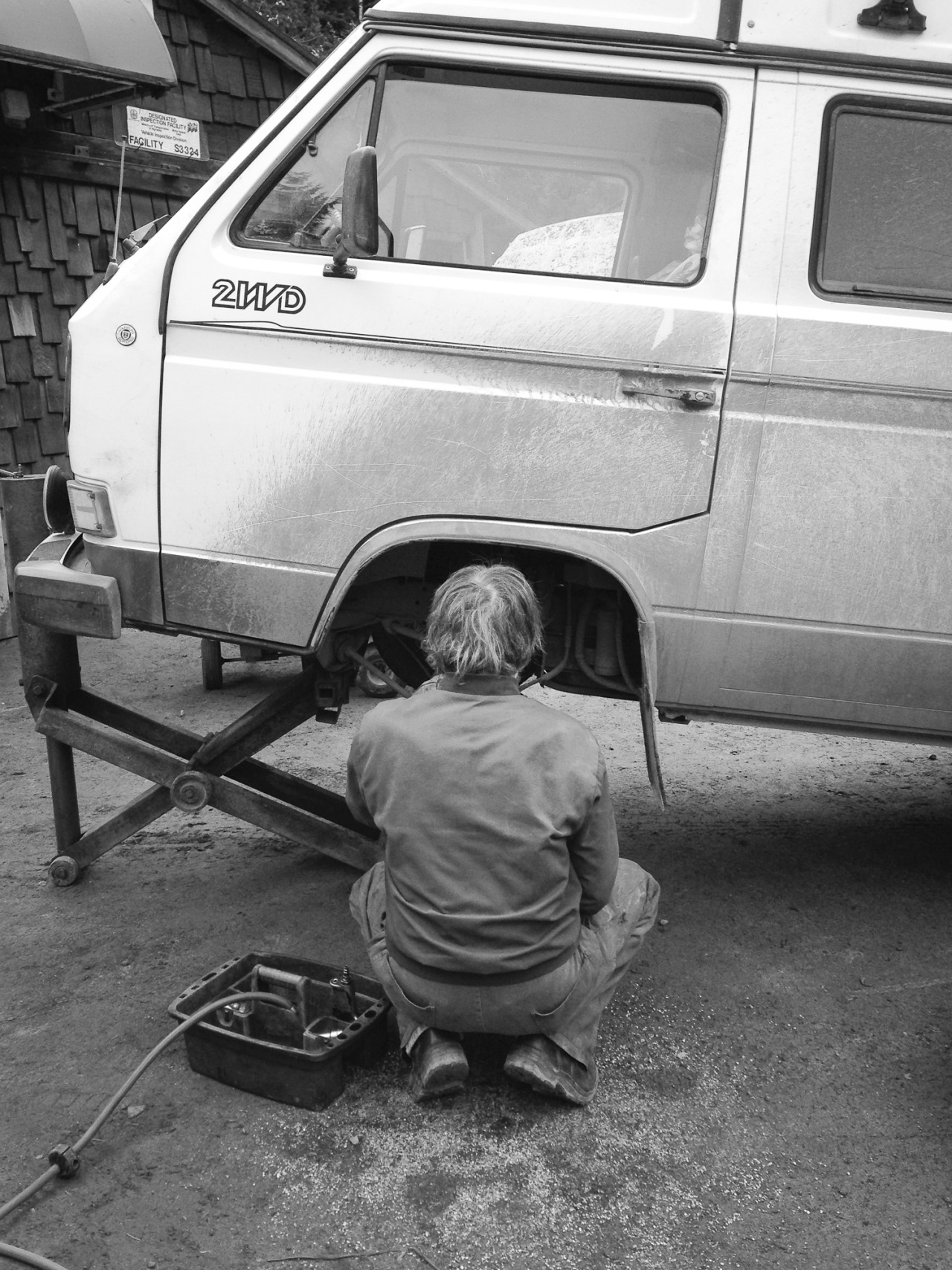 A mechanic works on my broken Volkswagen Vanagon