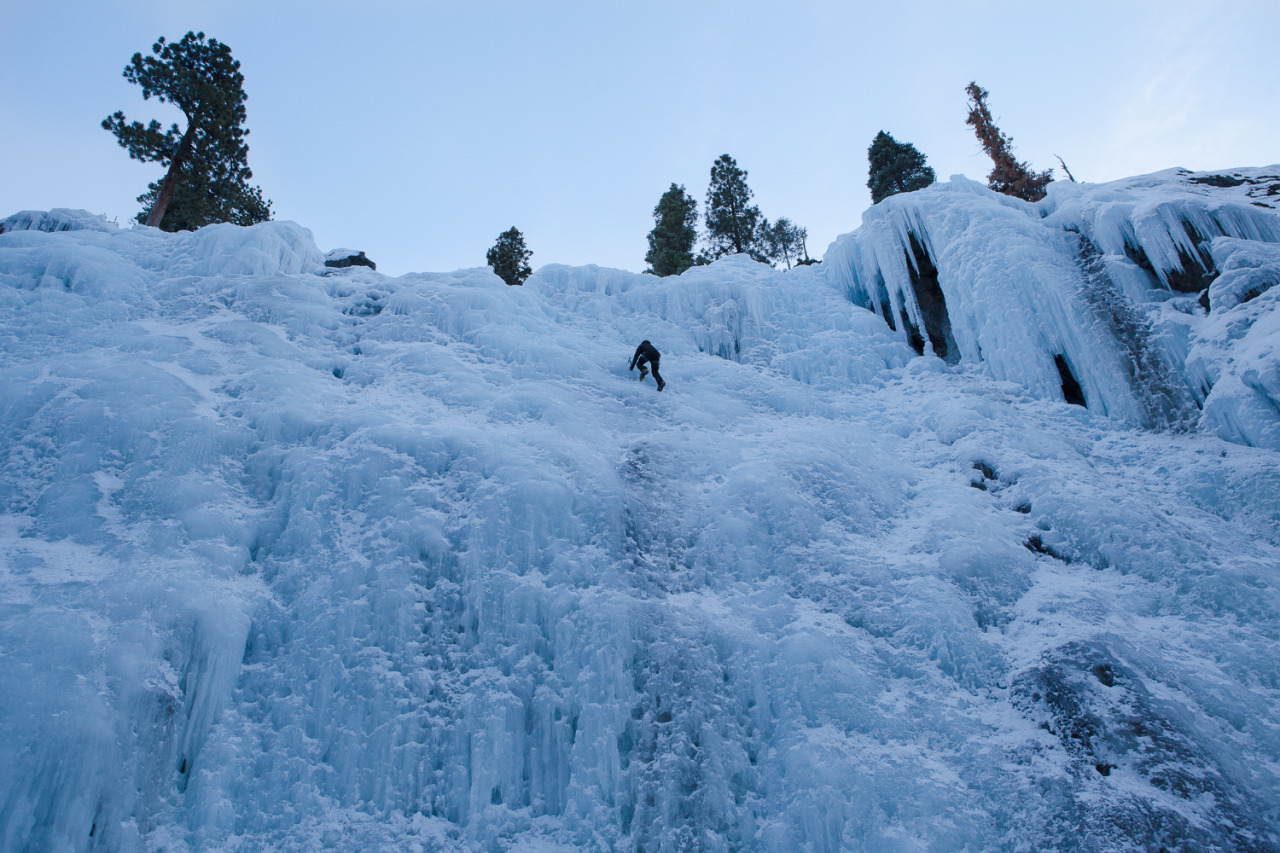 An ice climber ascends a solo ice fall deep in Ouray Canyon