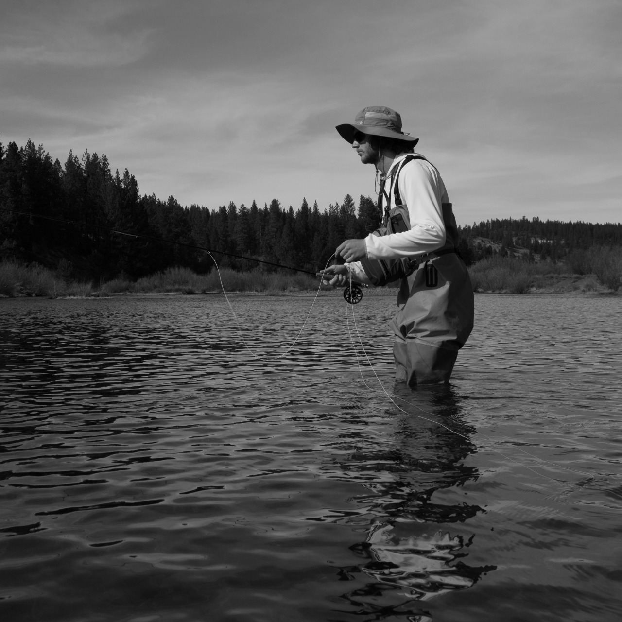 Jeff casts his fly rod in the Truckee river and waits for a bite