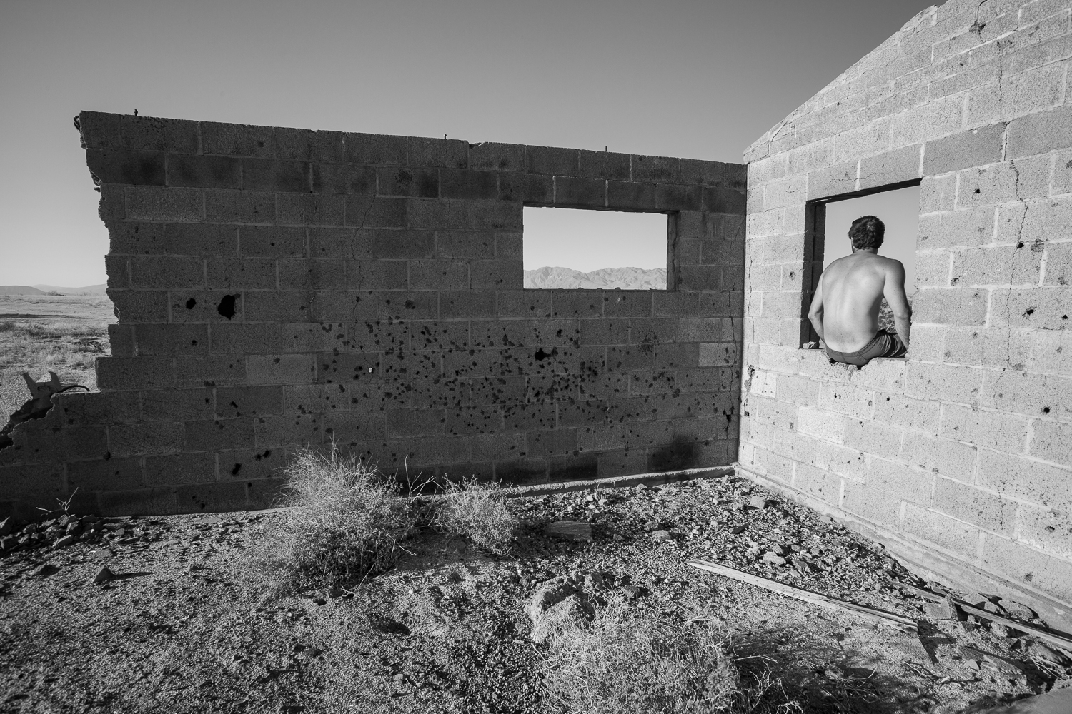 Sitting in abandoned structure while traveling through the Anza Borrego desert in California