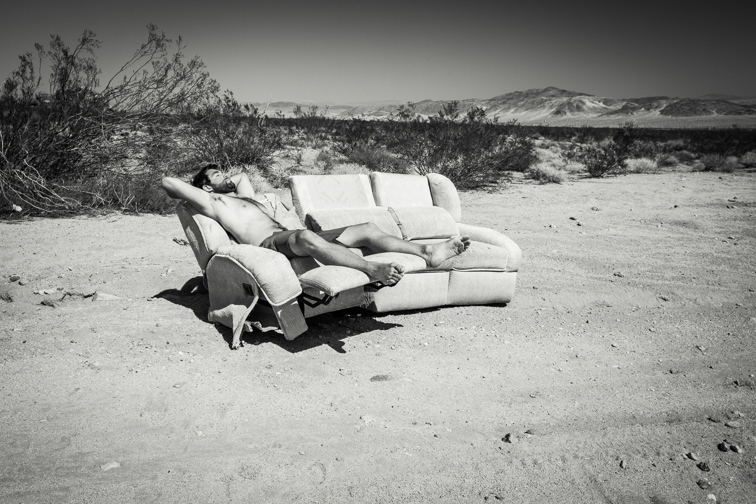 Taking a nap on an abandoned couch, somewhere in the middle of nowhere