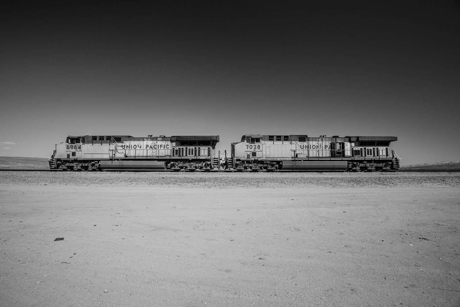 Two abandoned Union Pacific train engines in the California desert