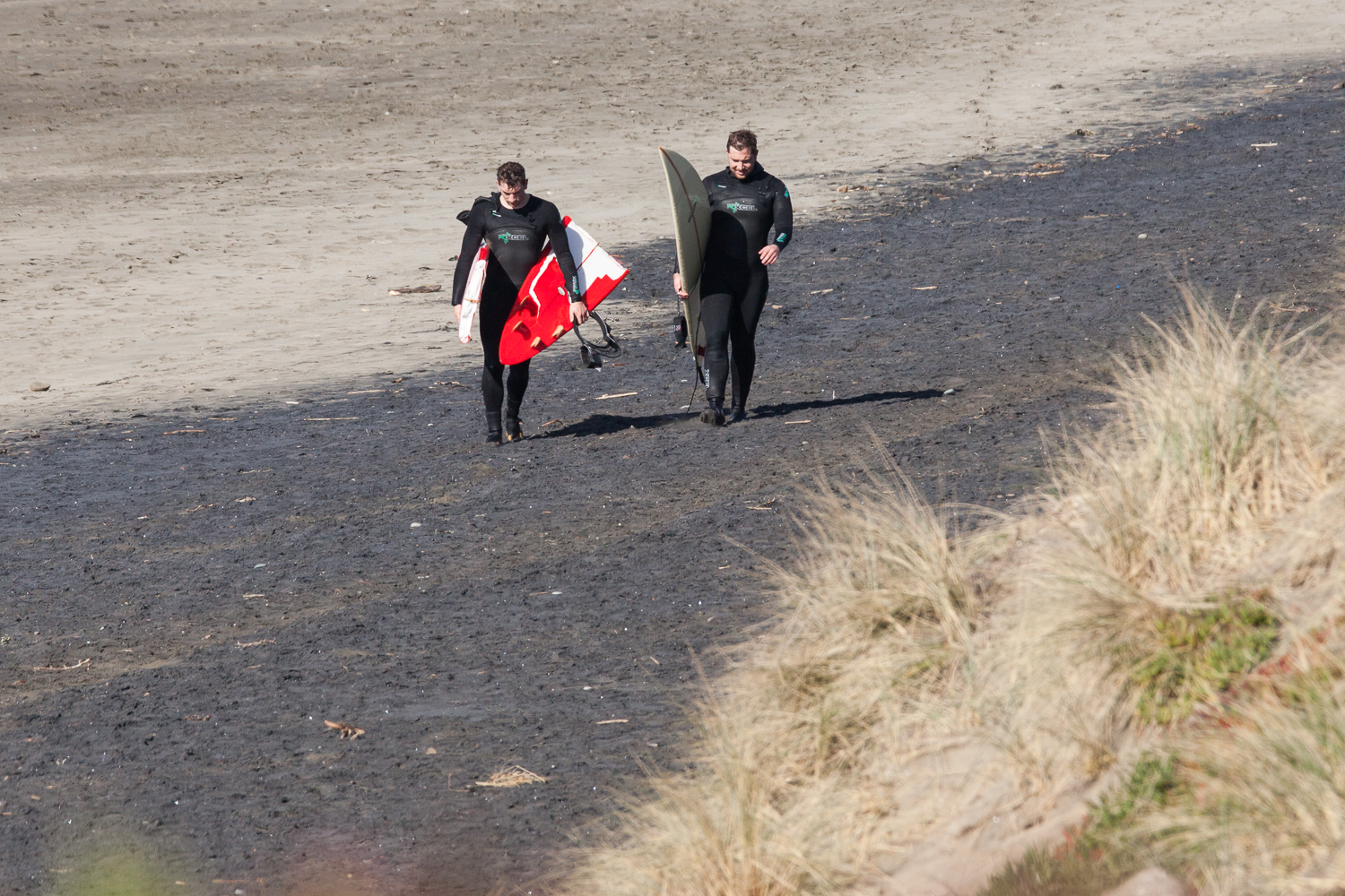 Keenan breaks his board after his first big wave at Ocean Beach, San Francisco