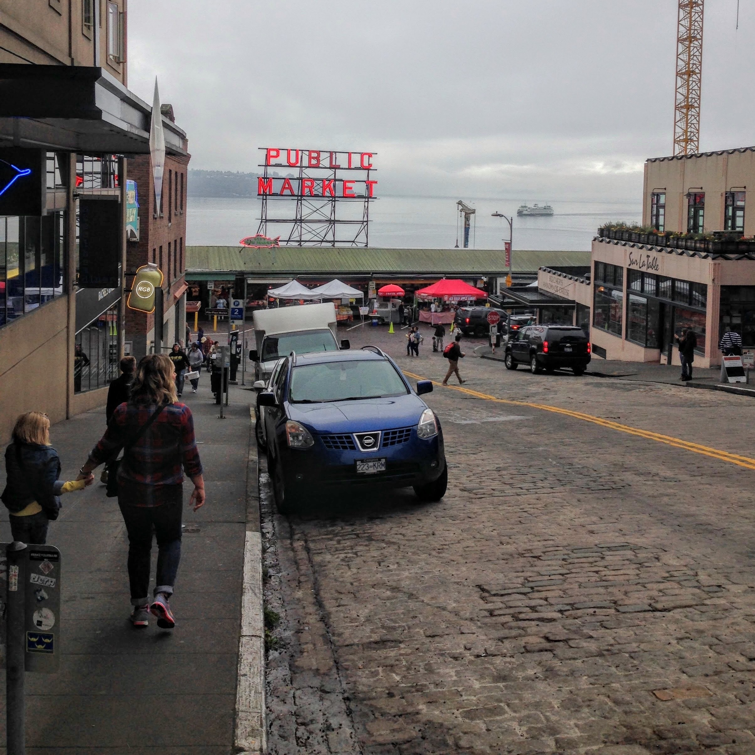 The iconic  Pike Place Market  with ferry boat on the water in the Sound.