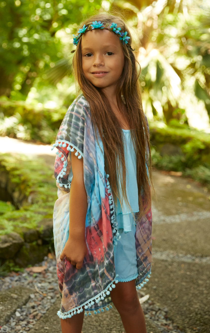 KIMONO JOLLY   Open front mid-length kimono w/ pom pom edges  100% RAYON   2/3   4/5   6/7   8/10  –   SHORTS DEEPSEA   Elastic lace waistband, w/ pom pom drastrings and lace trim hem  100% RAYON   2/3   4/5   6/7   8/10