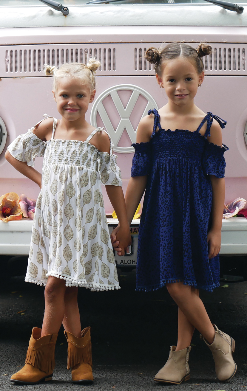 DRESS VANILLA   Cap slv smocked bodice, pom pom end spaghetti straps, pom pom bottom edge  100% RAYON | 2/3 | 4/5 | 6/7 | 8/10
