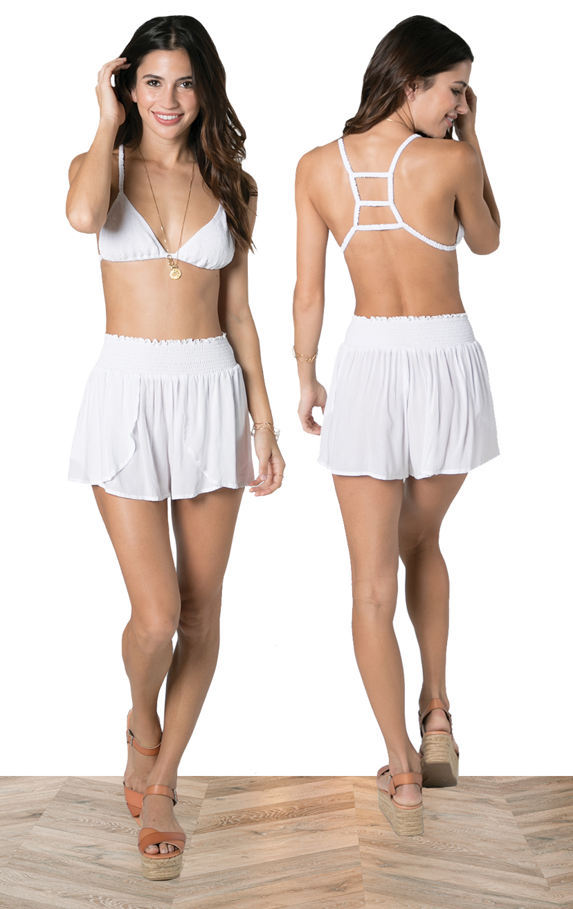TOP AYU   Top smocked bikini front with three tiered back detail  100% RAYON | XS/S, M/L  –   SHORTS CHASER   Wrap style shorts, elastic waist  100% RAYON | XS-S-M-L