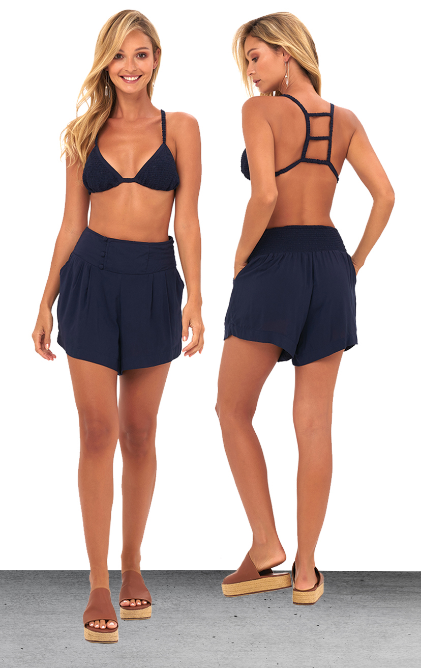 TOP AYU   Top smocked bikini front with three tiered back detail  100% RAYON | XS/S, M/L  –   SHORTS SKYLINE   Wide waistband shorts, back elastic, front button detail, side pockets  100% RAYON & LINE | XS-S-M-L