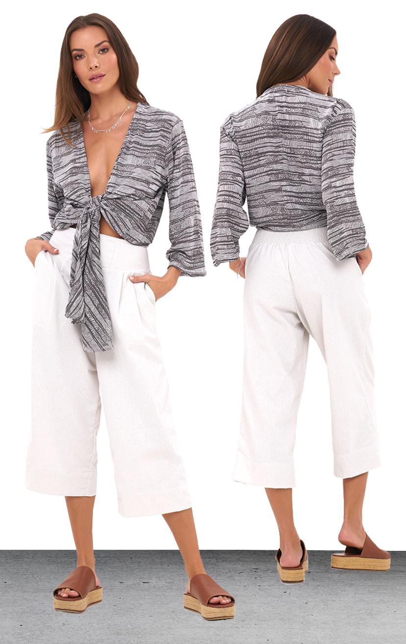 TOP SANTORINI   3/4 slv deep v-neck,front long tied crop blouse  100% RAYON | XS-S-M-L  –   PANT NOA   Wide waistband capri pant, back elastic, front button detail, side pockets  100% RAYON & LINE | XS-S-M-L