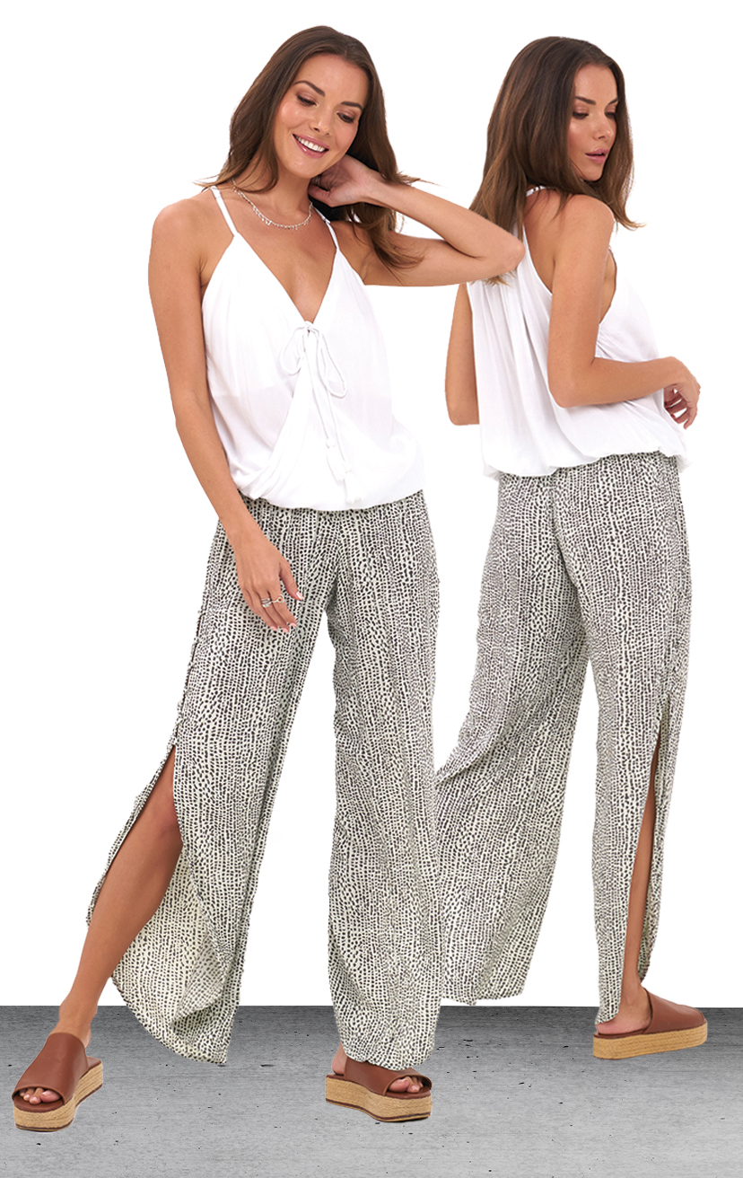 TOP PALOMA   Spaghetti strap racer- back, surplice front with tassel tie top  100% COTTON | XS-S-M-L  _   PANT SKY   Smock-waist pant, deep side slits w/ cover button detail, round bottom hem  100% RAYON | XS-S-M-L