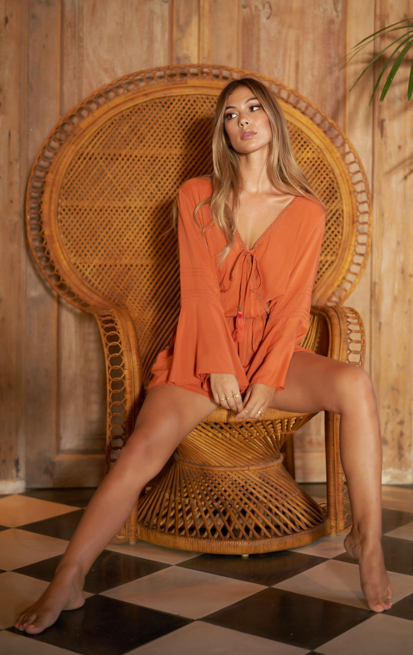 ROMPER KAIA   High-waist, front wrap bell-slv romper w/ beaded neckline & pkts  100% RAYON | XS-S-M-L