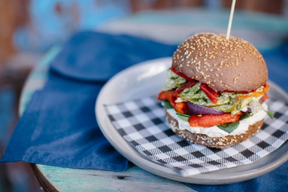 Carnivore Bliss Burger / chimichurri pulled chicken, charred capsicum, spanish onion, spinach and cashew cheese.