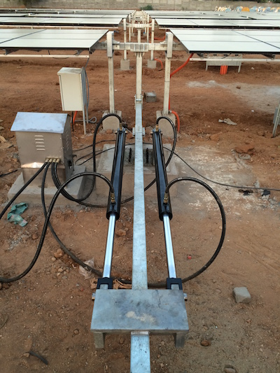 Rajvivik hydraulic cylinders and power unit moving a ganged solar tracker.