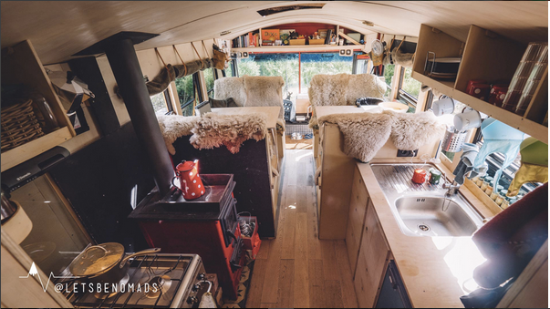 The inside of the Lets be Nomads adventure travel bus.