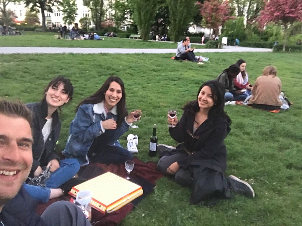 Coliving Members chilling at a park in Berlin Charlottenburg