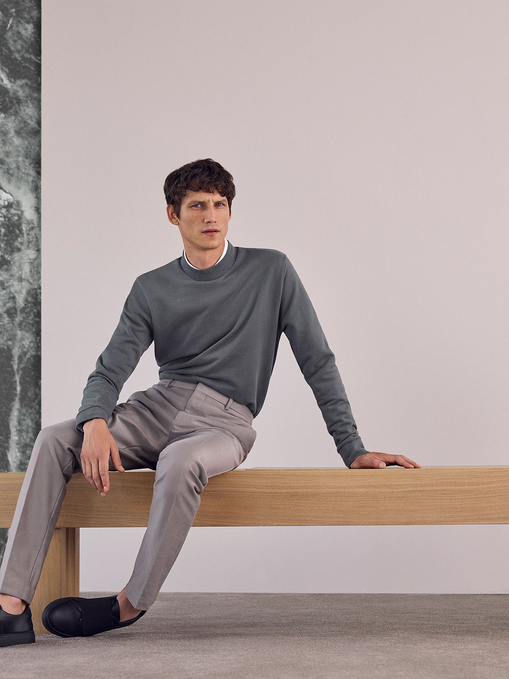 Rib detail sweatshirt , £39  Slim-fit cotton shirt , £55  Slim-fit tailored trousers , £79  Wrap-over leather sneakers , £89